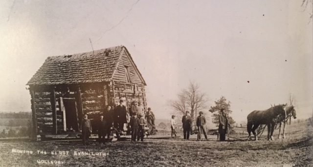 Moving Log Cabin College 1912