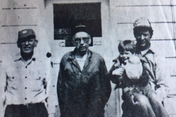 Fiehlers and Curt Palisch in front of garage