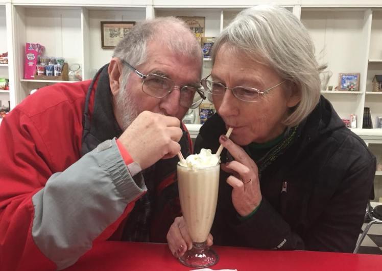 Warren and Sandi sharing a milkshake