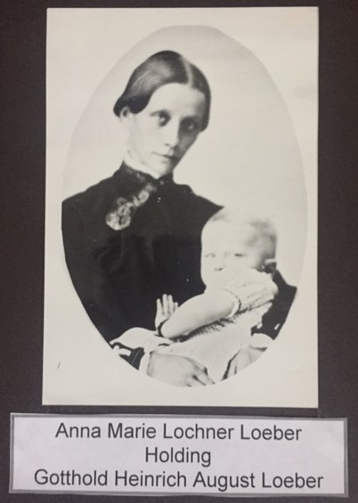 Anna Marie Loeber holding child
