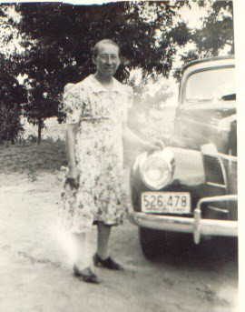 Anna Guetersloh with 1940 automobile