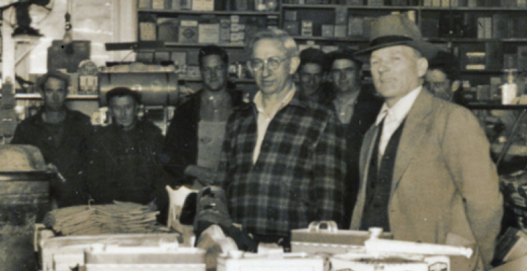 Willard Kieninger and Rev. Deye inside Mueller Store 1930's