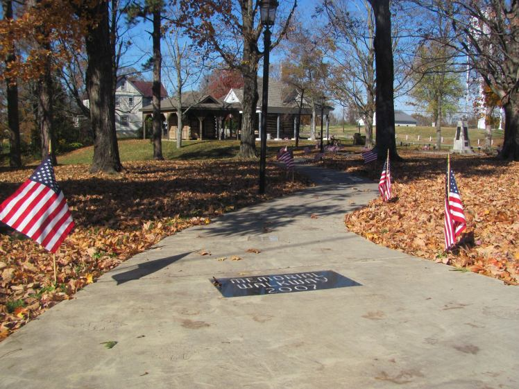 Memorial Walkway lined with flags Veterans Day